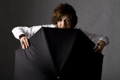Smiling woman with black umbrella Stock Photos