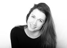 Smiling Woman - black and white. A woman smiles in front of a white background Royalty Free Stock Photos