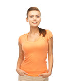 Smiling woman in blank color t-shirt Stock Images