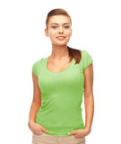 Smiling woman in blank green t-shirt Stock Images