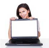 Smiling woman with blank laptop screen Stock Photo