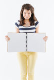 Smiling woman with blank notebook Stock Photo