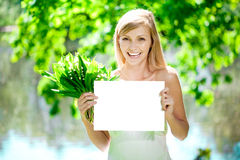 Smiling woman with blank poster  outdoors Royalty Free Stock Photo