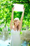 Smiling woman with blank poster  outdoors Stock Photography