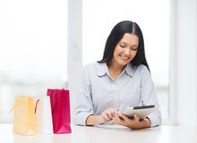 Smiling woman with blank screen tablet pc Stock Photo