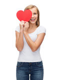 Smiling woman in blank white t-shirt with heart Stock Photography