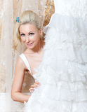 Smiling woman of the blonde with a white wedding dress Royalty Free Stock Photos