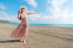 Smiling woman blowing sea wind breeze gestures Stock Images