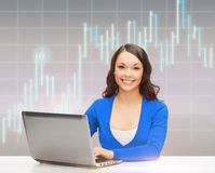 Smiling woman in blue clothes with laptop computer Stock Images