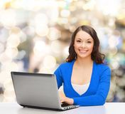 Smiling woman in blue clothes with laptop computer Stock Image