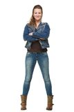 Smiling Woman in Blue Jeans with Arms Crossed Royalty Free Stock Image