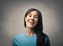 Smiling woman. Woman is smiling in blue pullover Royalty Free Stock Image