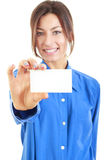 Smiling woman in blue shirt holds out a business or credit card Stock Photo