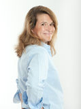 Smiling woman in blue shirt Stock Image