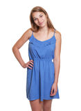 Smiling woman in a blue summer dress Stock Photography