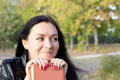 Smiling woman with a book Stock Photos