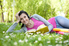 Smiling woman with book in nature royalty free stock photography