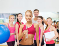 Smiling woman with bottle of water Stock Photos
