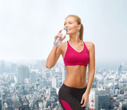 Smiling woman with bottle of water Royalty Free Stock Images