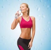 Smiling woman with bottle of water Royalty Free Stock Photography