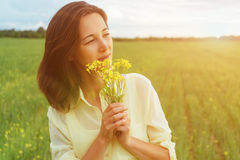 Smiling woman with bouquet of flowers Stock Photo