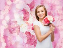 Smiling woman with bouquet of flowers. Holidays, love and flowers concept - young woman with bouquet of flowers Royalty Free Stock Photo