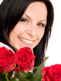 Smiling woman with bouquet of roses Stock Photos