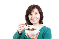 Smiling woman with bowl of chestnuts Royalty Free Stock Photos
