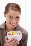 Smiling woman with bowl of fruit salad Stock Photo