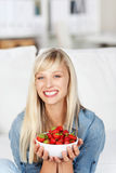 Smiling woman with a bowl of strawberries Stock Photo