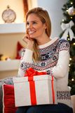 Woman with box with Christmas present at home Stock Images
