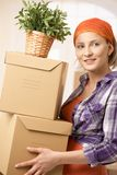 Smiling woman with boxes Stock Photos