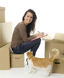 Smiling woman from boxes and cat Stock Photography