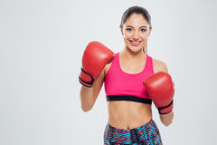 Smiling woman in boxing gloves looking at camera Stock Image