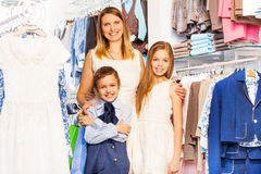 Smiling woman with boy and girl close in shop Royalty Free Stock Photography