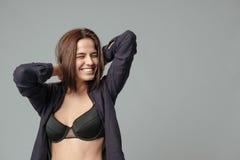 Smiling woman in bra Stock Image