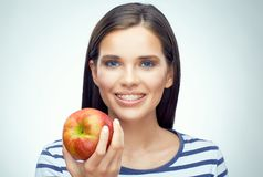 Smiling woman with braces holding apple. Isolated portrait Stock Photography