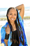Smiling woman in braids and sarong Stock Images
