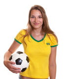 Smiling woman in brazilian shirt with football Royalty Free Stock Photos