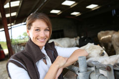 Smiling woman breeder in barn Stock Images