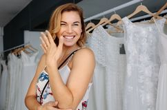 Smiling woman in bridal boutique stock images