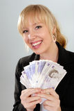 Smiling woman with British currency. Smiling attractive blond woman with British twenty pound notes stock photos