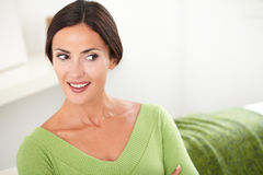 Smiling woman with brown hair looking away Royalty Free Stock Photo