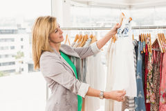 Smiling woman browsing clothes Stock Image
