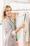 Smiling woman browsing clothes Royalty Free Stock Photography