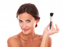 Smiling woman with brush for smooth her face Royalty Free Stock Photo