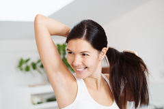 Smiling woman brushing her hair Royalty Free Stock Images