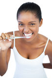 Smiling woman brushing her teeth Stock Image
