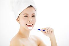 smiling woman brushing her teeth Royalty Free Stock Image