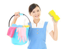 A smiling woman with a bucket Royalty Free Stock Photography